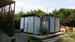 Санитарная зона: туалеты и летние душевые кабинки для отдыхающих в кемпинге